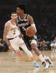 December 30, 2018; Los Angeles, CA, USA; Sacramento Kings guard De'Aaron Fox (5) moves the ball ahead of Los Angeles Lakers guard Lonzo Ball (2) during the first half at Staples Center. Mandatory Credit: Gary A. Vasquez-USA TODAY Sports