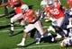 Jan 1, 2019; Pasadena, CA, USA; Washington Huskies linebacker Joe Tryon (9) tackles Ohio State Buckeyes linebacker Baron Browning (5) in the second quarter in the 2019 Rose Bowl at Rose Bowl Stadium. Mandatory Credit: Robert Hanashiro-USA TODAY Sports