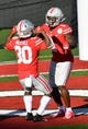 Jan 1, 2019; Pasadena, CA, USA; Ohio State Buckeyes wide receiver Johnnie Dixon (1) celebrates making a touchdown with running back Demario McCall (30) in the second quarter against the Washington Huskies in the 2019 Rose Bowl at Rose Bowl Stadium. Mandatory Credit: Robert Hanashiro-USA TODAY Sports