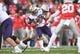 Jan 1, 2019; Pasadena, CA, USA; Ohio State Buckeyes defensive tackle Dre'Mont Jones (86) tackles Washington Huskies running back Myles Gaskin (9) in the first half  in the 2019 Rose Bowl at Rose Bowl Stadium. Mandatory Credit: Gary A. Vasquez-USA TODAY Sports