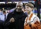 Jan 1, 2019; New Orleans, LA, USA; Former heavyweight boxing champion Evander Holyfield on the sidelines with a fan before the game between the Georgia Bulldogs and the Texas Longhorns in the 2019 Sugar Bowl at Mercedes-Benz Superdome. Mandatory Credit: Stephen Lew-USA TODAY Sports