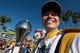 Jan 1, 2019; Tampa, FL, USA; Iowa Hawkeyes marching band drum major smiles in front of the stadium prior to the game between the Mississippi State Bulldogs and the Iowa Hawkeyes in the 2019 Outback Bowl at Raymond James Stadium. Mandatory Credit: Douglas DeFelice-USA TODAY Sports