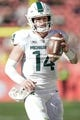 Dec 31, 2018; Santa Clara, CA, USA; Michigan State Spartans quarterback Brian Lewerke (14) holds onto the football against the Oregon Ducks during the second quarter at Levi's Stadium. Mandatory Credit: Stan Szeto-USA TODAY Sports