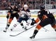 January 6, 2019; Anaheim, CA, USA; Edmonton Oilers center Ryan Nugent-Hopkins (93) moves the puck against Anaheim Ducks left wing Nick Ritchie (37) and defenseman Josh Mahura (76) during the first period at Honda Center. Mandatory Credit: Gary A. Vasquez-USA TODAY Sports