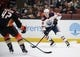 January 6, 2019; Anaheim, CA, USA; Edmonton Oilers right wing Jesse Puljujarvi (98) controls the puck against Anaheim Ducks defenseman Josh Manson (42) during the first period at Honda Center. Mandatory Credit: Gary A. Vasquez-USA TODAY Sports