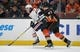 January 6, 2019; Anaheim, CA, USA; Edmonton Oilers center Connor McDavid (97) moves the puck against Anaheim Ducks defenseman Hampus Lindholm (47) during the first period at Honda Center. Mandatory Credit: Gary A. Vasquez-USA TODAY Sports