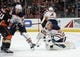 January 6, 2019; Anaheim, CA, USA; Edmonton Oilers goaltender Cam Talbot (33) blocks a shot as defenseman Darnell Nurse (25) defends against Anaheim Ducks right wing Carter Rowney (24) during the second period at Honda Center. Mandatory Credit: Gary A. Vasquez-USA TODAY Sports