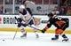 January 6, 2019; Anaheim, CA, USA; Edmonton Oilers center Connor McDavid (97) controls the puck against Anaheim Ducks defenseman Brandon Montour (26) during the third period at Honda Center. Mandatory Credit: Gary A. Vasquez-USA TODAY Sports