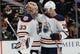 January 6, 2019; Anaheim, CA, USA; Edmonton Oilers goaltender Cam Talbot (33) and center Kyle Brodziak (28) celebrate the 4-0 shutout victory against the Anaheim Ducks at Honda Center. Mandatory Credit: Gary A. Vasquez-USA TODAY Sports