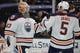 January 6, 2019; Anaheim, CA, USA; Edmonton Oilers goaltender Cam Talbot (33) and defenseman Kevin Gravel (5) celebrate the 4-0 shutout victory against the Anaheim Ducks at Honda Center. Mandatory Credit: Gary A. Vasquez-USA TODAY Sports
