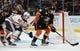 January 6, 2019; Anaheim, CA, USA; Anaheim Ducks defenseman Josh Mahura (76) clears the puck as Edmonton Oilers center Ryan Nugent-Hopkins (93) moves in during the third period at Honda Center. Mandatory Credit: Gary A. Vasquez-USA TODAY Sports