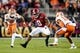 Jan 7, 2019; Santa Clara, CA, USA; Alabama Crimson Tide running back Josh Jacobs (8) runs the ball as Clemson Tigers cornerback A.J. Terrell (8) and defensive back K'Von Wallace (12) defend during the second quarter in the 2019 College Football Playoff Championship game at Levi's Stadium. Mandatory Credit: Kyle Terada-USA TODAY Sports