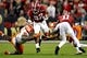 Jan 7, 2019; Santa Clara, CA, USA; Alabama Crimson Tide running back Najee Harris (22) runs the ball against Clemson Tigers defensive tackle Albert Huggins (67) during the first half during the 2019 College Football Playoff Championship game at Levi's Stadium. Mandatory Credit: Matthew Emmons-USA TODAY Sports