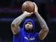 Jan 18, 2019; Los Angeles, CA, USA; Golden State Warriors center DeMarcus Cousins (0) shoots before playing against the Los Angeles Clippers in his first game returning from injury at Staples Center. Mandatory Credit: Robert Hanashiro-USA TODAY Sports