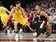 Feb 13, 2019; Portland, OR, USA;  Portland Trail Blazers guard CJ McCollum (3) dribbles behind his back to evade Golden State Warriors guard Klay Thompson (11) in the first half at Moda Center. Mandatory Credit: Jaime Valdez-USA TODAY Sports