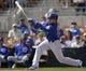 Feb 25, 2019; Phoenix, AZ, USA; Chicago Cubs shortstop Cristhian Adames (92) hits a single against the Los Angeles Dodgers during the first inning at Camelback Ranch. Mandatory Credit: Joe Camporeale-USA TODAY Sports