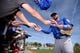 Mar 9, 2019; Scottsdale, AZ, USA; Chicago Cubs third baseman Kris Bryant (right) signs autographs for fans before the game against the San Francisco Giants at Scottsdale Stadium. Mandatory Credit: Orlando Ramirez-USA TODAY Sports
