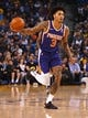 Mar 10, 2019; Oakland, CA, USA; Phoenix Suns forward Kelly Oubre Jr. (3) dribbles the ball against the Golden State Warriors during the first quarter at Oracle Arena. Mandatory Credit: Kelley L Cox-USA TODAY Sports