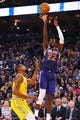 Mar 10, 2019; Oakland, CA, USA; Phoenix Suns center Deandre Ayton (22) shoots the ball above Golden State Warriors forward Kevin Durant (35) during the second quarter at Oracle Arena. Mandatory Credit: Kelley L Cox-USA TODAY Sports