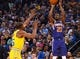 Mar 10, 2019; Oakland, CA, USA; Phoenix Suns guard Troy Daniels (30) scores a basket against Golden State Warriors forward Kevin Durant (35) during the second quarter at Oracle Arena. Mandatory Credit: Kelley L Cox-USA TODAY Sports