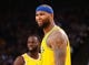 Mar 10, 2019; Oakland, CA, USA; Golden State Warriors center DeMarcus Cousins (0) reacts after being called for a foul against the Phoenix Suns during the third quarter at Oracle Arena. Mandatory Credit: Kelley L Cox-USA TODAY Sports