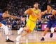 Mar 10, 2019; Oakland, CA, USA; Golden State Warriors guard Klay Thompson (11) drives to the basket against Phoenix Suns forward Kelly Oubre Jr. (3) and guard Devin Booker (1) during the third quarter at Oracle Arena. Mandatory Credit: Kelley L Cox-USA TODAY Sports
