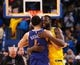 Mar 10, 2019; Oakland, CA, USA; Phoenix Suns guard Devin Booker (1) and Golden State Warriors forward Draymond Green (23) share a hug after the game at Oracle Arena. Mandatory Credit: Kelley L Cox-USA TODAY Sports