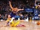 Mar 10, 2019; Oakland, CA, USA; Phoenix Suns guard Devin Booker (1) trips over Golden State Warriors guard Klay Thompson (11) chasing a loose ball during the fourth quarter at Oracle Arena. Mandatory Credit: Kelley L Cox-USA TODAY Sports