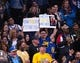 Mar 10, 2019; Oakland, CA, USA; Golden State Warriors fans hold up signs during a timeout against the Phoenix Suns during the fourth quarter at Oracle Arena. Mandatory Credit: Kelley L Cox-USA TODAY Sports