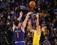 Mar 10, 2019; Oakland, CA, USA; Phoenix Suns guard Devin Booker (1) scores a basket against Golden State Warriors guard Stephen Curry (30) during the fourth quarter at Oracle Arena. Mandatory Credit: Kelley L Cox-USA TODAY Sports