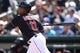 Mar 13, 2019; Goodyear, AZ, USA; Cleveland Indians second baseman Jose Ramirez (11) hits a single against the Milwaukee Brewers during the first inning at Goodyear Ballpark. Mandatory Credit: Joe Camporeale-USA TODAY Sports