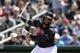 Mar 13, 2019; Goodyear, AZ, USA; Cleveland Indians first baseman Carlos Santana (41) bats against the Milwaukee Brewers during the first inning at Goodyear Ballpark. Mandatory Credit: Joe Camporeale-USA TODAY Sports