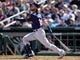 Mar 13, 2019; Goodyear, AZ, USA; Milwaukee Brewers left fielder Ben Gamel (16) bats against the Cleveland Indians during the second inning at Goodyear Ballpark. Mandatory Credit: Joe Camporeale-USA TODAY Sports