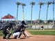 Mar 13, 2019; Goodyear, AZ, USA; Milwaukee Brewers shortstop Tyler Saladino (13) bats against the Cleveland Indians during the fifth inning at Goodyear Ballpark. Mandatory Credit: Joe Camporeale-USA TODAY Sports