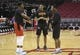Mar 15, 2019; Houston, TX, USA; Houston Rockets forward Danuel House Jr. (4) talks with Phoenix Suns guard De'Anthony Melton (14) and teammate prior to their game at Toyota Center. Mandatory Credit: Thomas B. Shea-USA TODAY Sports