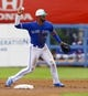 Mar 17, 2019; Dunedin, FL, USA; Toronto Blue Jays shortstop Lourdes Gurriel Jr. (13) throws to first during the first inning of a game against the Minnesota Twins at Dunedin Stadium. Mandatory Credit: Butch Dill-USA TODAY Sports