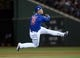 Mar 20, 2019; Mesa, AZ, USA; Chicago Cubs shortstop Javier Baez (9) follows through on a throw against the Los Angeles Dodgers during the second inning at Sloan Park. Mandatory Credit: Joe Camporeale-USA TODAY Sports