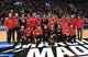 Mar 21, 2019; Salt Lake City, UT, USA; Utah Utes NCAA championship ski team pose for a photo at mid court at halftime in the first round of the 2019 NCAA Tournament between the Fairleigh Dickinson Knights and the Gonzaga Bulldogs at Vivint Smart Home Arena. Mandatory Credit: Kirby Lee-USA TODAY Sports
