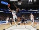 Mar 21, 2019; Salt Lake City, UT, USA; Gonzaga Bulldogs guard Zach Norvell Jr. (23) shoots over Fairleigh Dickinson Knights forward Mike Holloway Jr. (34) during the second half in the first round of the 2019 NCAA Tournament at Vivint Smart Home Arena. Mandatory Credit: Kirby Lee-USA TODAY Sports