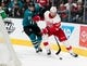 Mar 25, 2019; San Jose, CA, USA; Detroit Red Wings right wing Anthony Mantha (39) and San Jose Sharks defenseman Justin Braun (61) battle for the puck in the first period at SAP Center at San Jose. Mandatory Credit: John Hefti-USA TODAY Sports