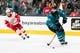 Mar 25, 2019; San Jose, CA, USA; San Jose Sharks defenseman Brent Burns (88) skates with the puck as Detroit Red Wings left wing Taro Hirose (53) defends in the first period at SAP Center at San Jose. Mandatory Credit: John Hefti-USA TODAY Sports