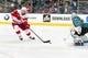 Mar 25, 2019; San Jose, CA, USA; Detroit Red Wings center Dylan Larkin (71) scores a goal against San Jose Sharks goaltender Martin Jones (31) in the first period at SAP Center at San Jose. Mandatory Credit: John Hefti-USA TODAY Sports