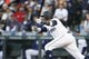 Mar 30, 2019; Seattle, WA, USA; Seattle Mariners shortstop Tim Beckham (1) hits an RBI-single against the Boston Red Sox during the first inning at T-Mobile Park. Mandatory Credit: Joe Nicholson-USA TODAY Sports