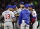 Mar 30, 2019; Arlington, TX, USA; Chicago Cubs teammates gather around starting pitcher Yu Darvish, middle, as pitching coach Tommy Hottovy calls a meeting on the mound during the second inning in a baseball game against the Texas Rangers at Globe Life Park in Arlington. Mandatory Credit: Jim Cowsert-USA TODAY Sports