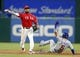 Mar 30, 2019; Arlington, TX, USA; Chicago Cubs center fielder Albert Almora Jr. (5) is forced out at second base as Texas Rangers shortstop Elvis Andrus (1) throws to first on a fielders choice during the second inning in a baseball game at Globe Life Park in Arlington. Mandatory Credit: Jim Cowsert-USA TODAY Sports