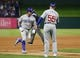 Mar 30, 2019; Arlington, TX, USA; Chicago Cubs designated hitter Kyle Schwarber (12) is congratulated by third base coach Brian Butterfield (55) as he rounds the bases on his home run against the Texas Rangers during the fifth inning in a baseball game at Globe Life Park in Arlington. Mandatory Credit: Jim Cowsert-USA TODAY Sports