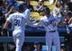 Mar 31, 2019; Los Angeles, CA, USA; Los Angeles Dodgers left fielder Joc Pederson (31) shakes hands with center fielder Enrique Hernandez (14) after scoring on a sacrifice fly in the first inning against the Arizona Diamondbacks at Dodger Stadium. Mandatory Credit: Jayne Kamin-Oncea-USA TODAY Sports