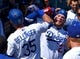 Mar 31, 2019; Los Angeles, CA, USA; Los Angeles Dodgers center fielder Cody Bellinger (35) is greeted in the dugout by center fielder Alex Verdugo (27) after hitting a solo home run in the third inning against the Arizona Diamondbacks at Dodger Stadium. Mandatory Credit: Jayne Kamin-Oncea-USA TODAY Sports