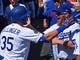 Mar 31, 2019; Los Angeles, CA, USA; Los Angeles Dodgers center fielder Cody Bellinger (35) is greeted in the dugout by third baseman Justin Turner (10) after hitting a solo home run in the third inning against the Arizona Diamondbacks at Dodger Stadium. Mandatory Credit: Jayne Kamin-Oncea-USA TODAY Sports