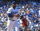 Mar 31, 2019; Los Angeles, CA, USA; Los Angeles Dodgers relief pitcher Pedro Baez (52) rubs the baseball as Arizona Diamondbacks starting pitcher Luke Weaver (24) rounds the bases after hitting a solo home run in the fourth inning of the game at Dodger Stadium. Mandatory Credit: Jayne Kamin-Oncea-USA TODAY Sports